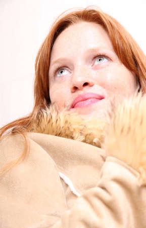 A attractive young, redhead  woman in Winter clothing    photo