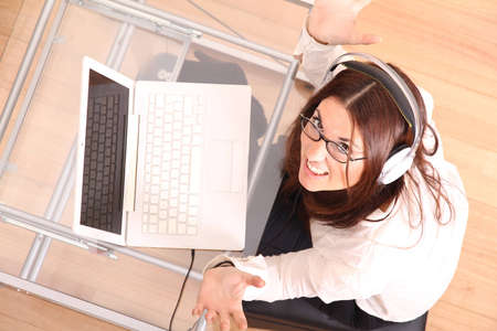 Cheerful business woman working on a Laptop  Stock Photo - 16305680