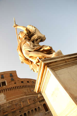 Statue in Rome in front of the Castel Sant Angelo  photo