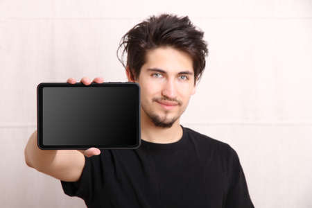 tablet pc: A young hispanic man holding a Tablet PC  Stock Photo
