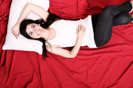 A young hispanic Woman sleeping on the Bed  photo