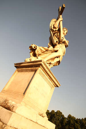 Statue in Rome, Italy close to the Castel Sant Angelo  photo