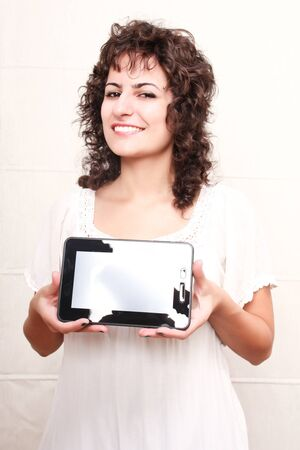 A young woman holding a Tablet PC Stock Photo - 19378372
