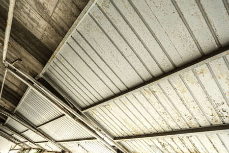 A industrial garage ceiling with open gates  photo