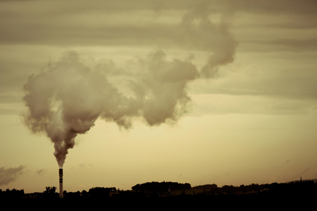 A retro-style Photo of a polluting factory.