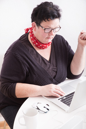 Portrait of an overweight mature woman in the office.  photo