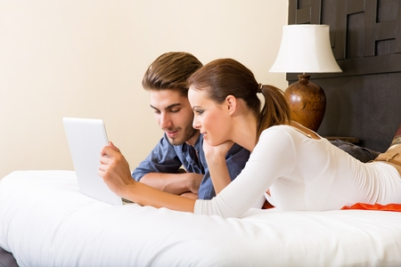 Young couple using a laptop computer in a asian hotel room