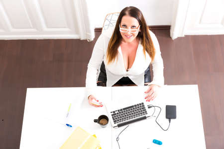 Big and Beautiful Secretary working in a office Stock Photo - 80477702