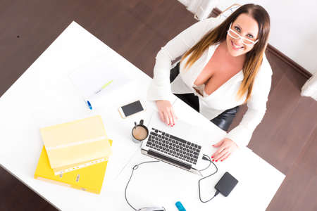 Big and Beautiful Secretary working in a office