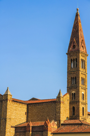 View on the bell tower of the Santa Croce church in Florence, Italy on a sunny day.