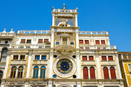 View on the St Marks Clocktower in San Marco Square in Venice, Italy on a sunny day. Stock fotó