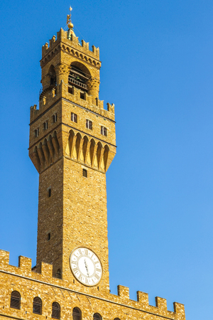 View on the old palace called Palazzo Vecchio in Florence, Italy on a sunny day.
