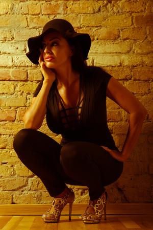 Mature woman crouching