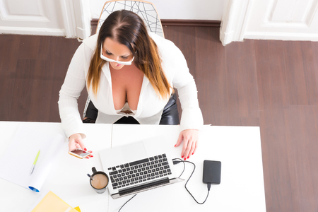 Big and Beautiful Secretary working in a office Stock Photo - 112809795