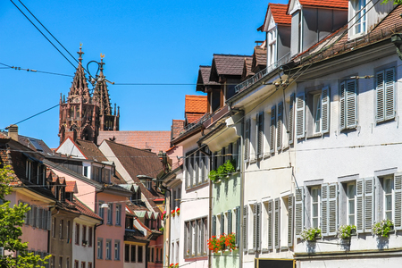 View on the historic town of Freiburg im Breisgau, Germany with the Freiburg Minster cathedral on a sunny day. Banco de Imagens