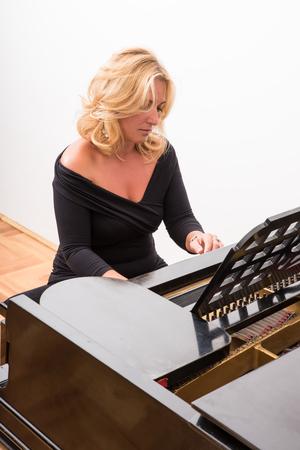 pretty woman playing a piano
