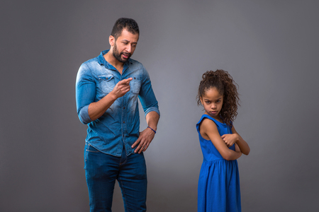 Young black father with his teenage daughter Stock Photo