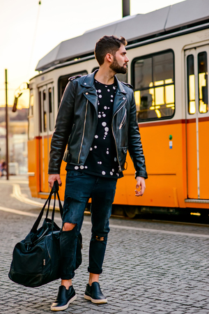 Young hipster man next to the tramline