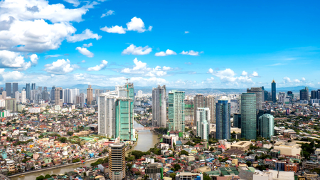 Skyline of Manila by the River Pasig