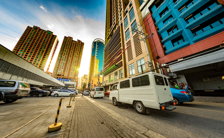 MANILA, PHILIPPINES - CIRCA MARCH 2018: View on daily life on the streets of the city as cars and pedestrians pass by during the day circa March, 2018 in Manila, Philippines. Editorial