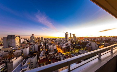 Dusk view on the skyline of the city from a balcony of a high rise apartment in Buenos Aires, Argentina. Banco de Imagens - 120576388