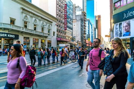 BUENOS AIRES, ARGENTINA - CIRCA NOVEMBER 2018: View on traffic and pedestrians pass by in the center of the city circa November 2018 in Buenos Aires, Argentina. Redakční