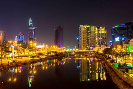 HO CHI MINH CITY, VIETNAM - CIRCA FEBRUARY 2018: View of the river and the skyline in Ho Chi Minh City at night circa February 2018 in Ho Chi Minh City, Vietnam. Redakční