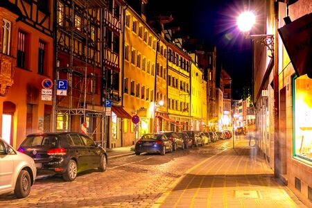 NUREMBERG, GERMANY - CIRCA MAY 2019: View on daily life in the historic centre of the medieval city at night circa May 2019 in Nuremberg, Germany. Redakční