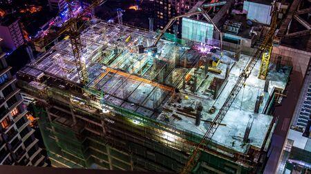 MANILA, PHILIPPINES - CIRCA MARCH 2018: View on construction site of a skyscraper at night circa March, 2018 in Manila, Philippines.