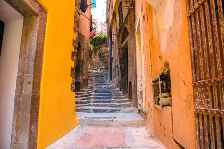 Old rock stairs between the colourful houses in Cinque Terry, Italy on a sunny day. Reklamní fotografie