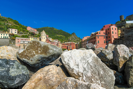 View over the the historic architecture of Cinque Terre, Italy with colourful houses on a sunny day.