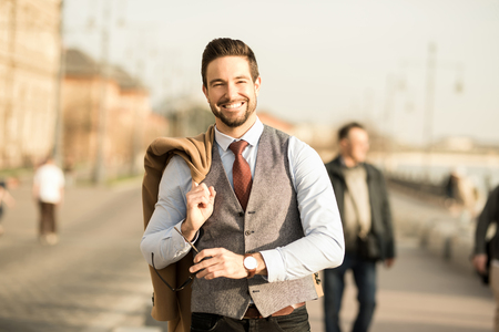 An elegant man walking on the streets. Reklamní fotografie