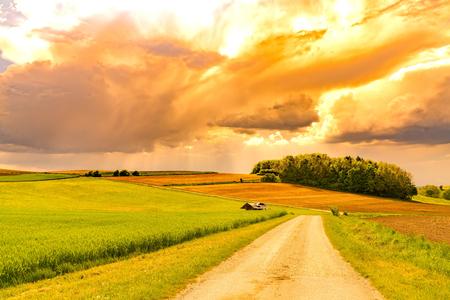 A stormy sky over a idyllic bavarian landscape in southern Germany. Reklamní fotografie