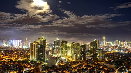 View on the illuminated skyline of Makati during sunset.