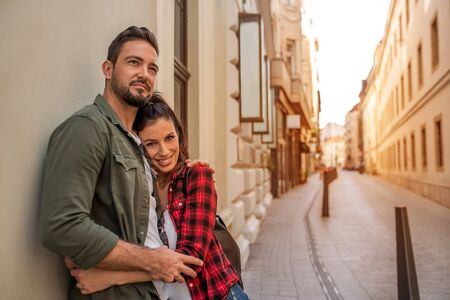 A couple in love hugging each other in a European city.. Stock Photo