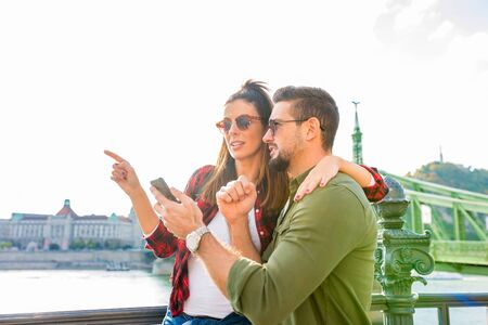 A happy couple discovering together a city during their holidays.. Stock Photo