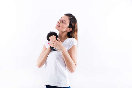 Young woman holding weight