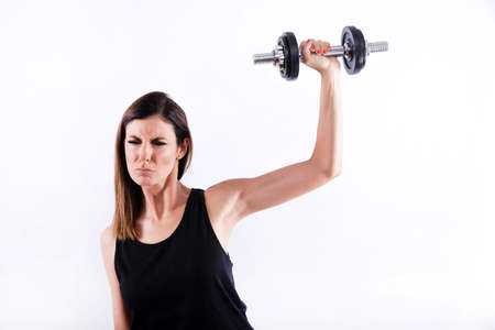 Young woman lifting weight Banque d'images