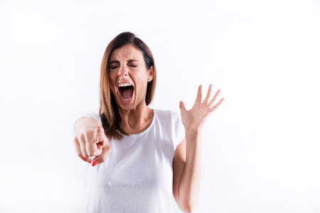 Screaming woman pointing Banque d'images
