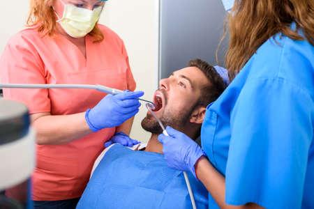 A patient getting treatment in a dental studio Banque d'images
