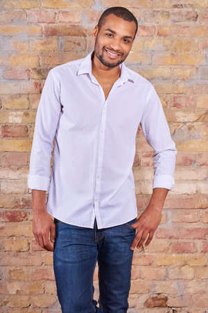 Portrait of a happy handsome young man in a white shirt.