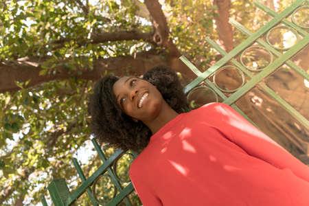Portrait of a beautiful black woman in a park.