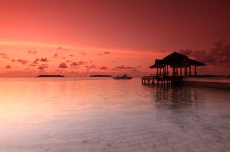 Sunset at Kandooma recreational jetty, Maldives