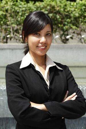 Portrait of a smiling Asian businesswoman outdoors