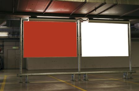 carpark: Two blank signboards in an underground carpark with clipping paths