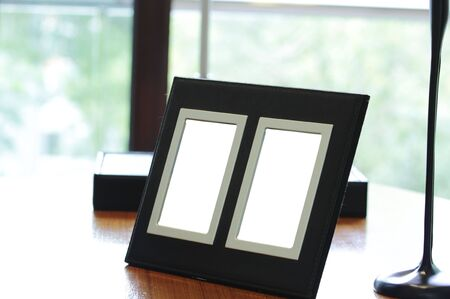 Two photo frames on a wooden table Stock Photo