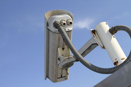 Rear view of a security camera against a blue sky Stock Photo - 6855869