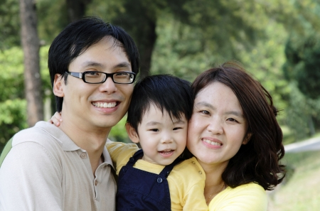 family outing: A happy Asian family at a public park