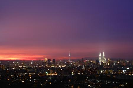 A view of the Kuala Lumpur city skyline at sunset