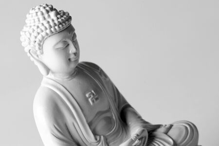 A small white Buddha statue